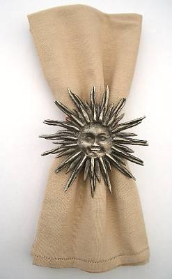 Pewter sun on serviette